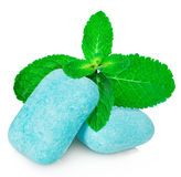 Chewing gum with mint leaves close-up on a white background. Stock Image