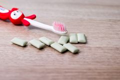 Chewing gum and toothbrush royalty free stock photos