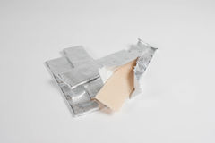 Chewing gum is on the white background with paper. Chewing gum is on the white background Royalty Free Stock Photo