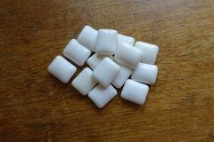 Chewing gum on wooden table. From above royalty free stock photos