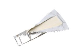 Chewing gum. In wrapping paper in front of a white background Stock Images