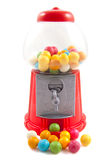 Chewing gumballs. Colorful gumballs in and in front of gumball machine isolated over white Royalty Free Stock Photo