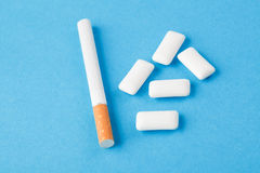 Chewing gums and cigarette Stock Images