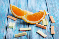 Chewing gums with orange Stock Photos