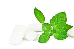 Chewing gym and fresh leaves of mint Royalty Free Stock Photography