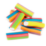 Chewy Candies. Heap of Striped Colorful Chewy Candies isolated on white background royalty free stock images
