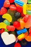 Chewy Candy. A handful of colorful, chewy candy on a blue plate Royalty Free Stock Photography