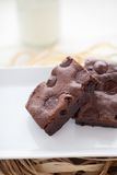 Chewy Fudgy Homemade Brownies. Chocolate brownies dessert on the white plate and straw Royalty Free Stock Images