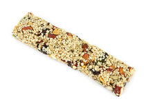 Chewy nut covered energy bar Royalty Free Stock Images