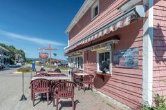 Chez Chantal, lobster rolls, La Malbaie, Quebec. Chez Chantal, lobster rolls restaurant set in a pink small building near the St.Lawrence River shore, La Malbaie royalty free stock images
