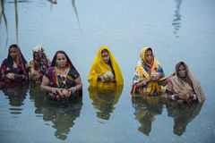 Chhat puja celebration at River by women Stock Photos