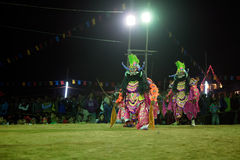 Chhau Dance, Indian tribal martial dance at night in village. BAMNIA, PURULIA, WEST BENGAL , INDIA - DECEMBER 23RD 2015 : Dancers dressed as demons , performing stock photo