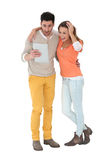 Chherful couple using tablet with surprised look. Cheerful couple using digital tablet, isolated Stock Photos