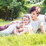 Chherful family relaxing in the city park Stock Photography