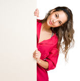 Chherful young brunette with blank banner. Stock Photography
