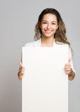 Chherful young brunette with blank banner. Stock Images