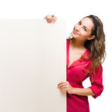 Chherful young brunette with blank banner. Stock Photos