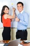 Chińczyk drużyna w reklamowej agenci obrazy stock