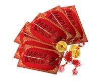 Chińska czerwona paczka z złocistymi monetami Zdjęcie Royalty Free