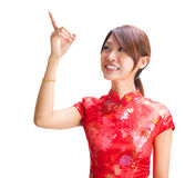 Chińska dziewczyna wskazuje przy pustą przestrzenią Zdjęcia Stock