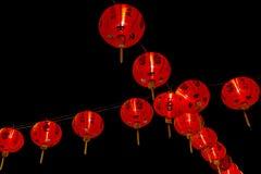 Chińska nowy rok dekoracja--Czerwoni lampiony na błyskotliwości, bokeh zdjęcia stock