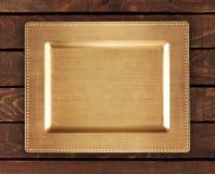 Chińska złota taca na bambusowym stole Wschodni tło dla jedzenia Fotografia Royalty Free