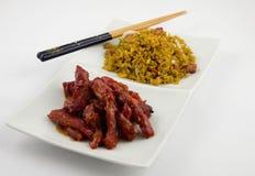 Chiński Jedzenie - z Wieprzowiną smażącą Bezkostni dodatkowi ziobro Obrazy Royalty Free