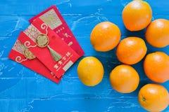 Chińskie nowy rok dekoracje pomarańczowe i kopertowe Zdjęcia Royalty Free
