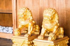 Chińskiej figurki singha złoty partner Zdjęcie Stock