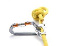 Chi ascende rampicante, corda, carabiner, nodo isolato su bianco clim fotografia stock
