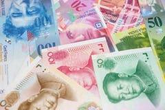 Chińczyk Juan i Szwajcarscy franki notatka Zdjęcia Stock