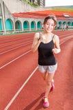 Chińska kobieta jogging w rasie Obraz Royalty Free