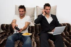 Chi volete per essere? Gamer o uomo d'affari Immagini Stock
