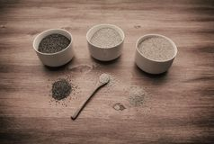 Chia amaranth and quinoa on table royalty free stock images