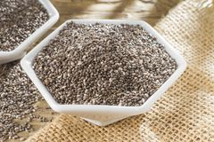 Chia beans in bowl on old wooden background Salvia hispanica. Chan beans in bowl on old wooden background Salvia hispanica stock photo