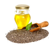 Chia oil with seed on the white background. Stock Photo