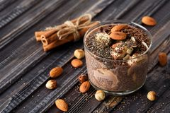 Chia pudding with chocolate banana smoothie in a glass jar on the old wooden background stock photography