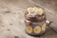Chia pudding with chocolate banana smoothie. In a glass jar on the old wooden background Stock Image