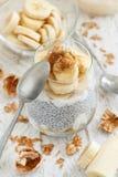 Chia pudding parfait with banana. Chia pudding parfait, layered with banana and granola Stock Image