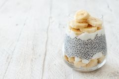 Chia pudding parfait with banana. Chia pudding parfait, layered with banana and yogurt Royalty Free Stock Image