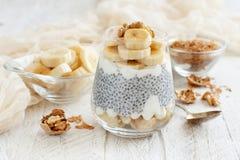 Chia pudding parfait with banana. Chia pudding parfait, layered with banana and granola Royalty Free Stock Photo