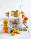 Chia pudding parfait with kumquat. Chia pudding parfait, layered with kumquat  and granola Stock Photo