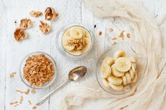 Chia pudding parfait with banana. Chia pudding parfait, layered with banana and granola Royalty Free Stock Photos
