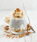 Chia pudding parfait with banana. Chia pudding parfait, layered with banana and granola Stock Photography