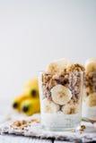 Chia pudding parfait, layered yogurt with banana, granola. Copy space Royalty Free Stock Photo