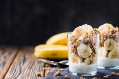 Chia pudding parfait, layered yogurt with banana, granola. Copy space. Chia pudding parfait, layered yogurt with banana, granola. Healthy breakfast concept. Copy stock image