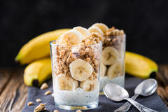Chia pudding parfait, layered yogurt with banana, granola. Healthy breakfast Stock Image