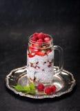 Chia pudding with raspberries, strawberries and granola Stock Photo