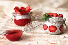 Chia pudding with strawberries in small bowls on a linen tablecloth Stock Image