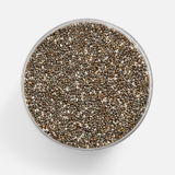 Chia seed in a glass jar with a soft shadow Royalty Free Stock Photos